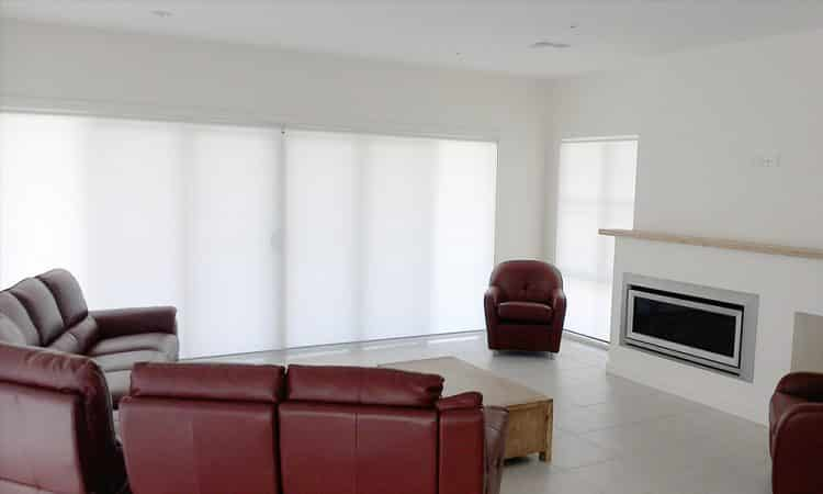 White Roller Blinds In A Room Filled with Sofas