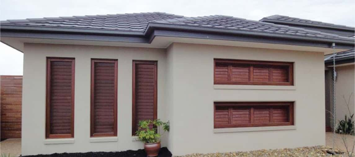 House With Timber Shutters On All Windows