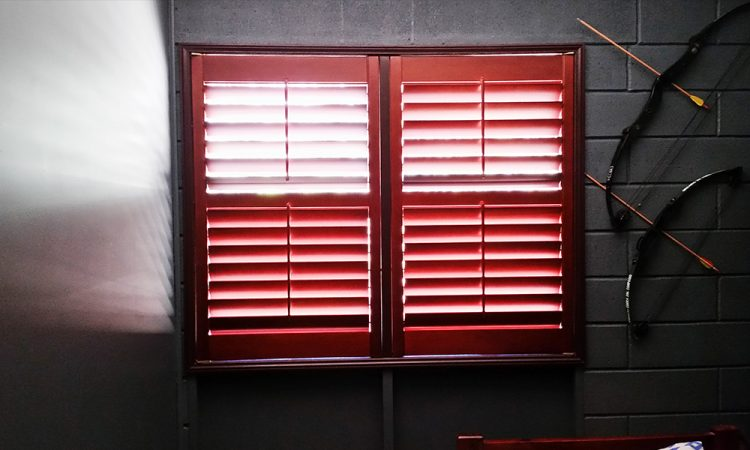 Sun Passing Through Window with Red Timber Shutter