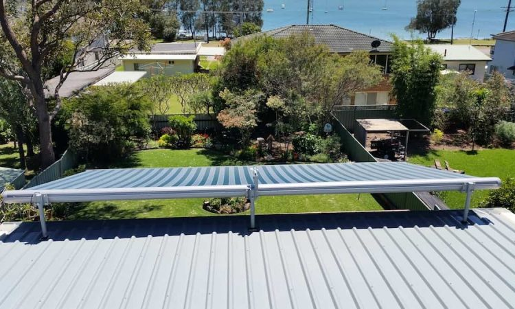 Top View Of Striped Blue Retractable Markilux Awning